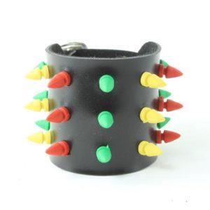 Bracelet Force Poignet Décoré Pics Pointes en Plastique Vertes Jaunes Rouges